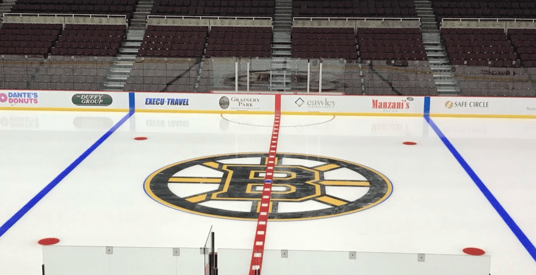 A Boston Bruins logo has been painted on Canucks' old home ice in Vancouver