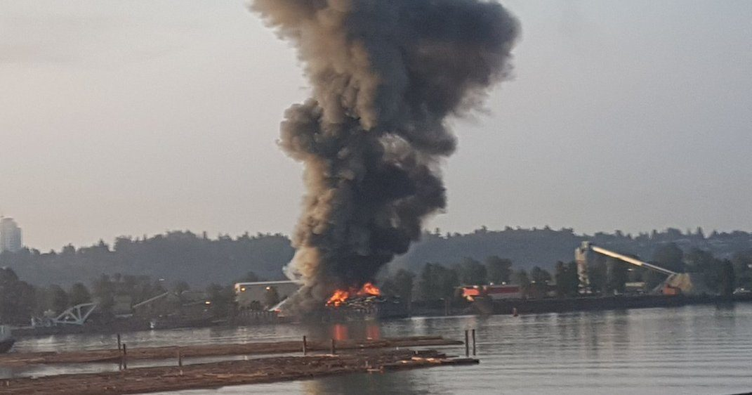 Large fire erupts on barge in Surrey this morning