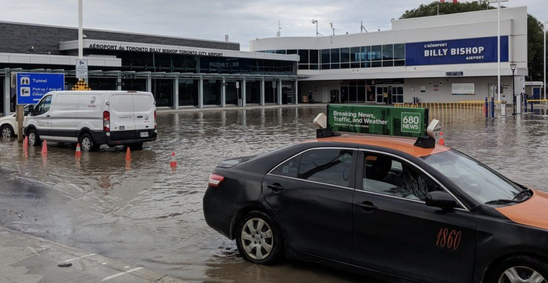 A broken water main has flooded the streets outside Billy Bishop Airport