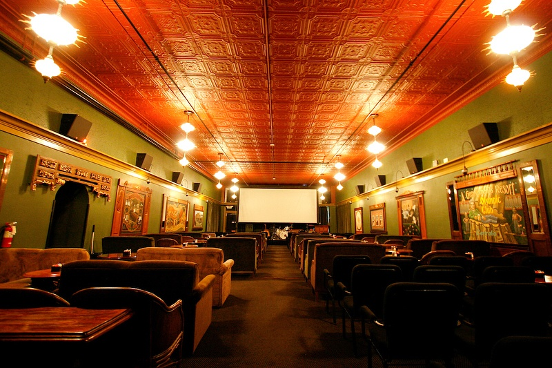 A McMenamins movie theatre decked out with tables and coaches (@mcmenamins / Instagram)