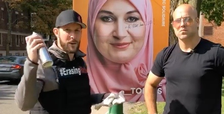 Graffiti-removal group erases defaced Muslin election sign (VIDEO)