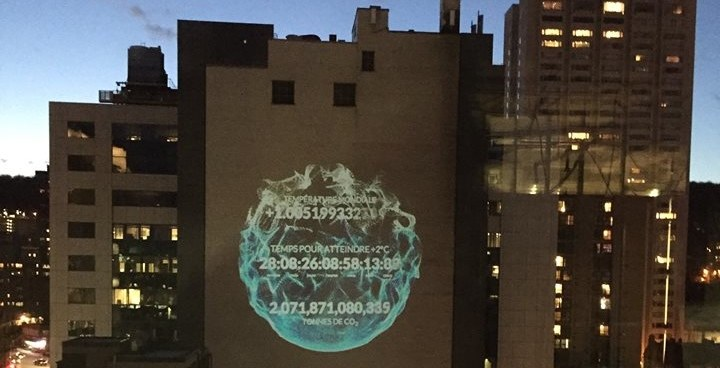 A massive doomsday climate clock is being projected in downtown Montreal