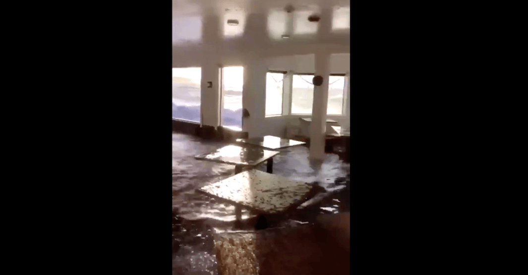 Restaurant windows blown out by waves in wind storm (VIDEO)