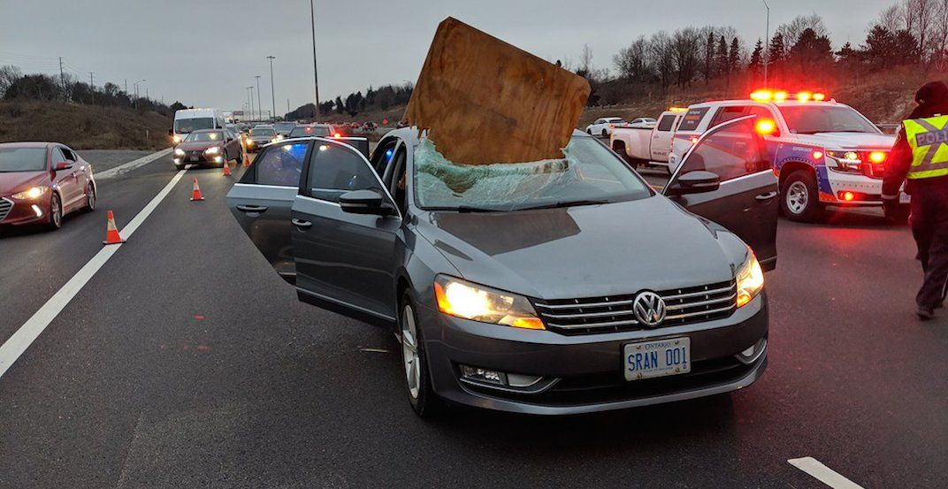 Large sheet of plywood smashes into car on Highway 410 in close call (VIDEO)