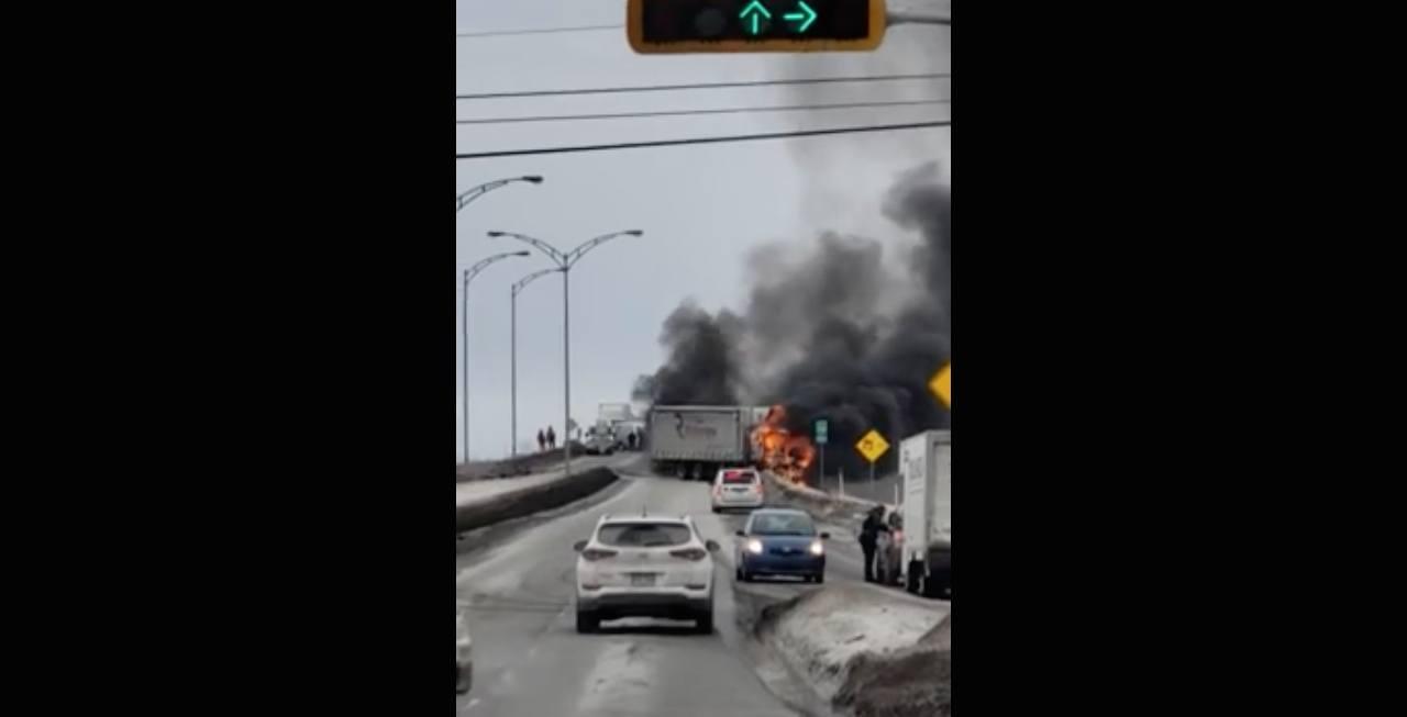 A three-vehicle collision sends dark smoke over a Joliette highway