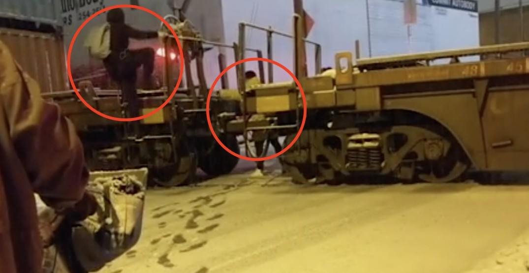 These people hopped over railroad tracks while a train was crossing in Vancouver (VIDEO)