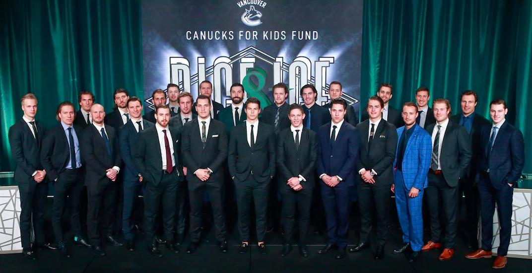 New Canucks player didn't get the matching suit memo (PHOTO)