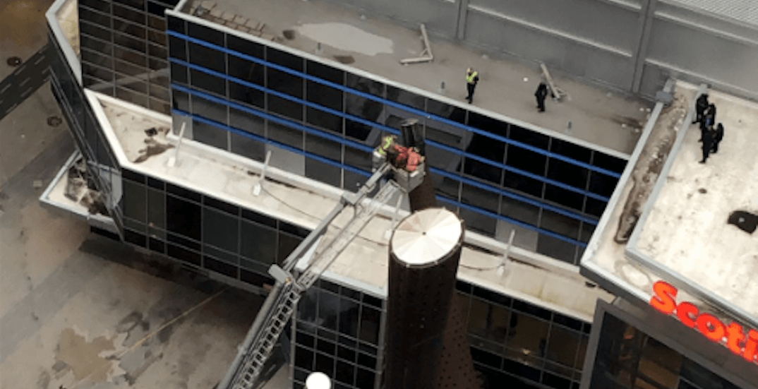 Man charged for scaling 70-ft sculpture outside Scotiabank Arena during wind storm