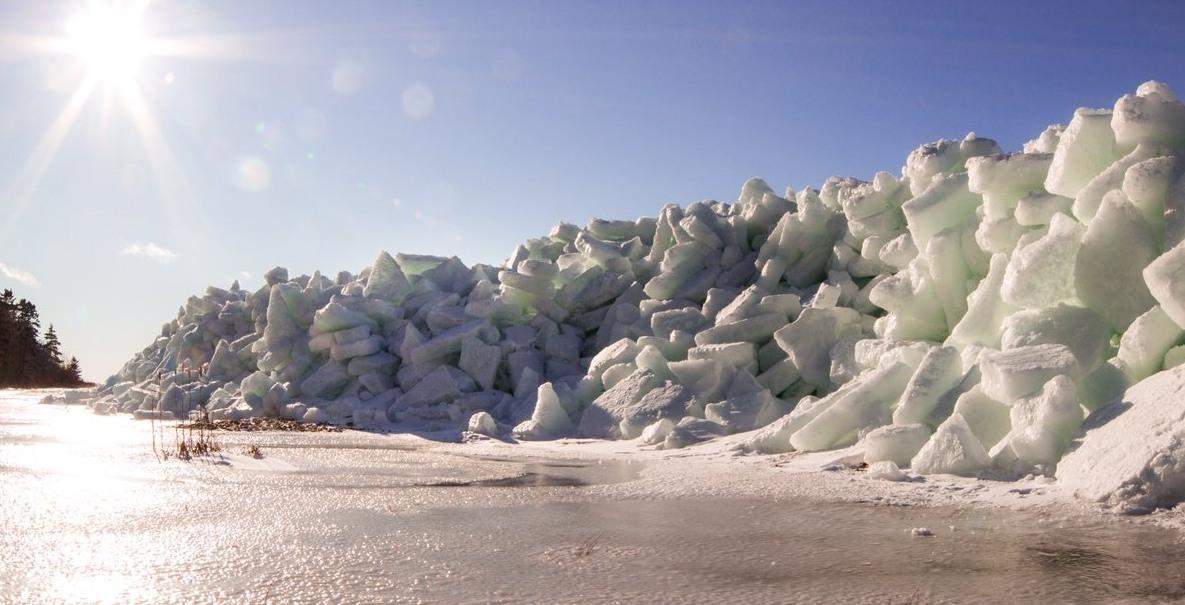 'Ice tsunami' creates majestic ice wall along shoreline of Canadian town (PHOTOS)