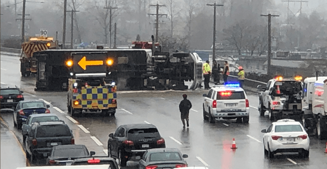 Major delays expected after semi-truck flips on Highway 1 in Burnaby