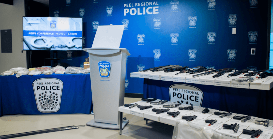 $1.2M worth of drugs and 26 firearms seized in major bust