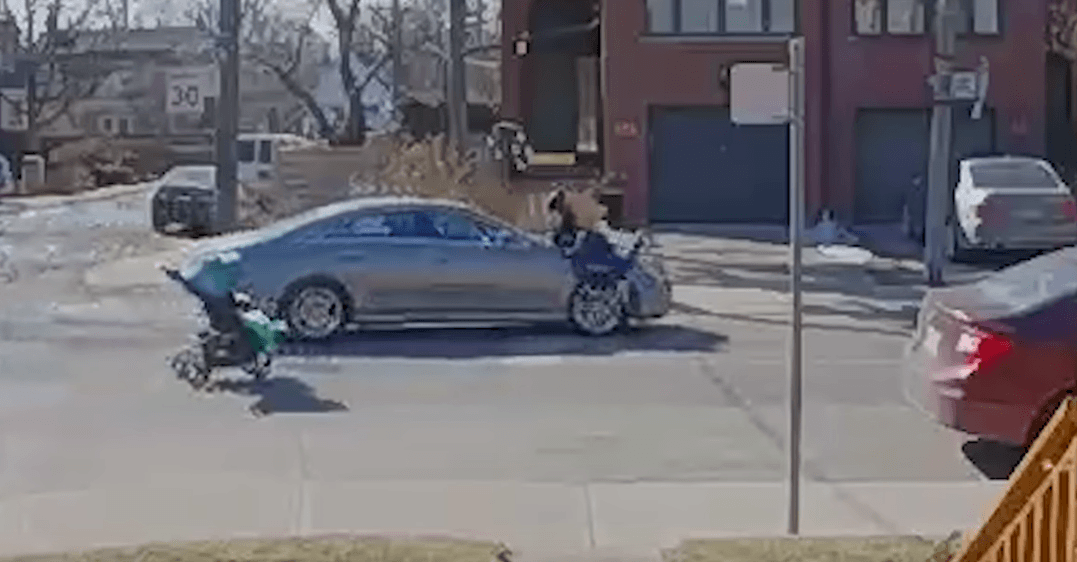 Woman pushing stroller almost hit by vehicle (VIDEO)