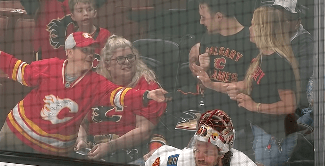 Flames fan brought to tears after generosity of extremely nice kid (VIDEO)