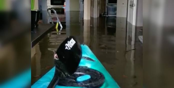 Quebec woman shares devastating moments kayaking through her flooded home (VIDEO)