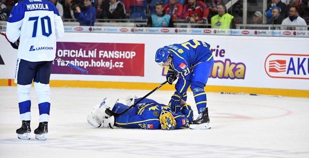 Canucks goalie Markstrom injured after violent collision in game for Sweden (VIDEO)