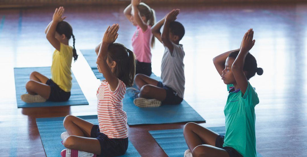 You can attend a FREE family-friendly yoga class downtown on May 15