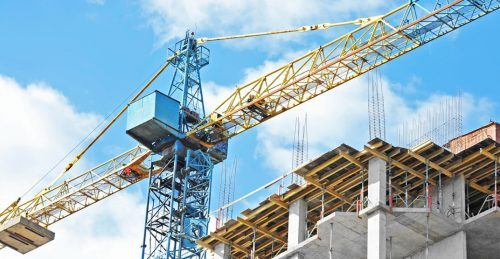 Construction crane for a building. (Shutterstock)