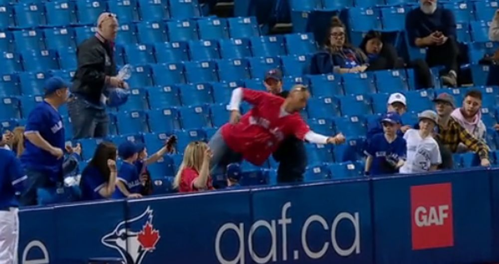 Blue Jays fan makes hilariously stylish catch in stands (VIDEO)
