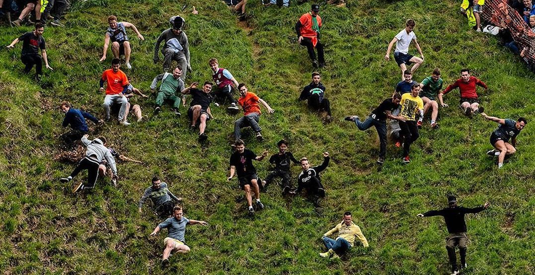 Canadian man crowned champion of British cheese-rolling race (PHOTOS)
