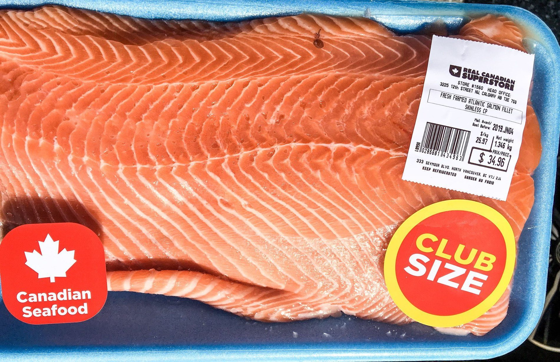 Biologist alarmed after buying farmed salmon with sea louse on it from grocery store