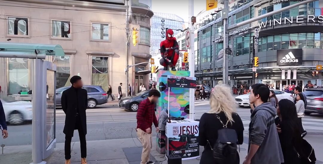 Spider-Man performer gets into intense standoff with religious group at Yonge-Dundas (VIDEO)