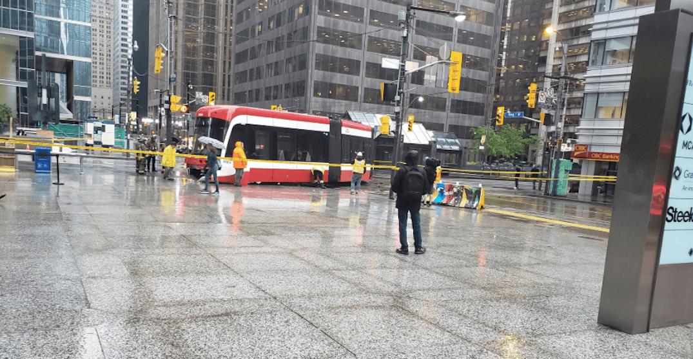 TTC streetcar derails onto sidewalk after crash at King and University
