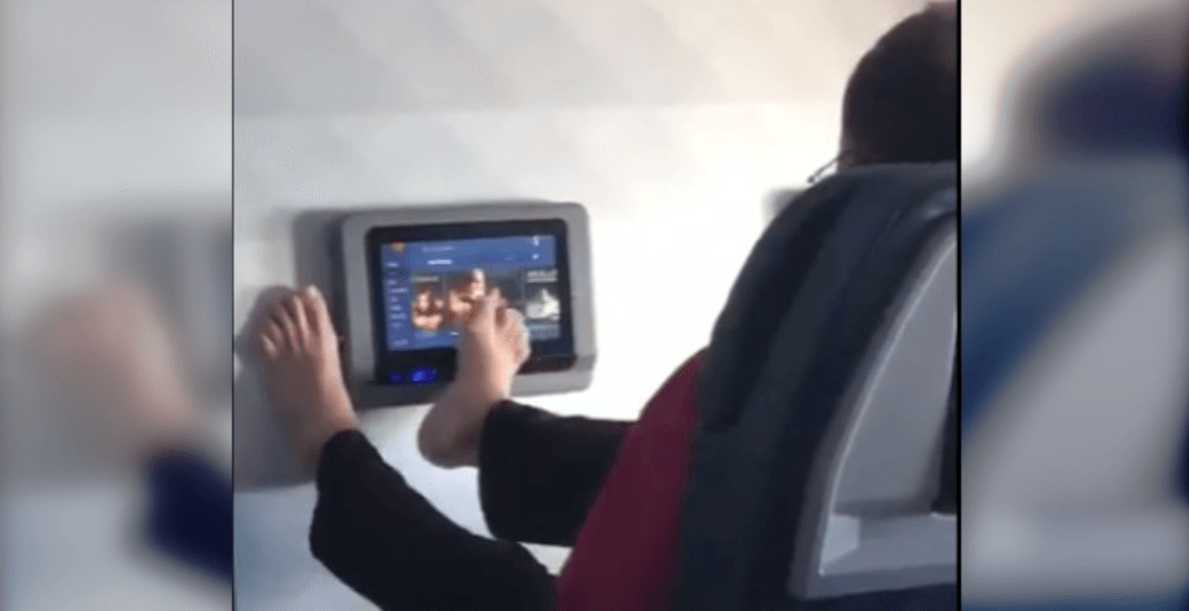 Viral video shows air passenger using feet to choose in-flight movie