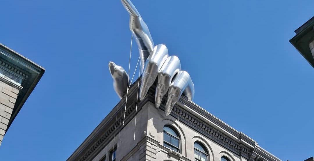 A giant hand has taken over the top of this building in Montreal (PHOTOS)