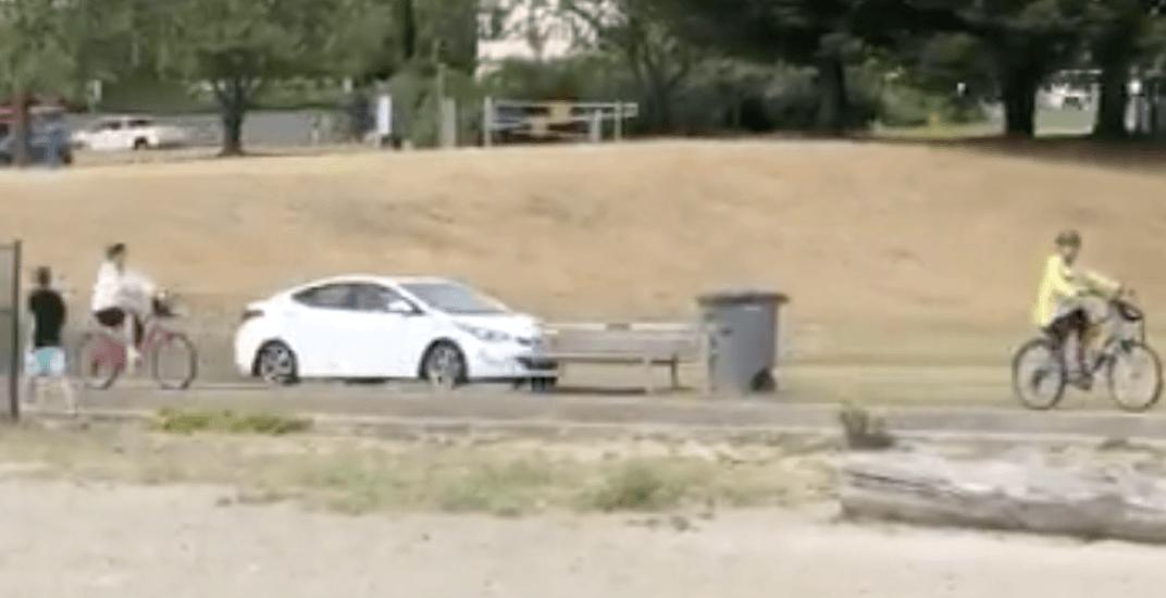 Motorist takes car for a cruise along pedestrian path at Sunset Beach (VIDEO)