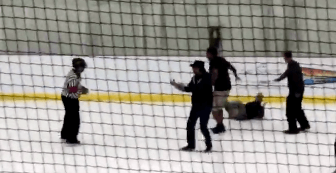 2 men arrested after allegedly charging ice at kids' hockey game (VIDEO)