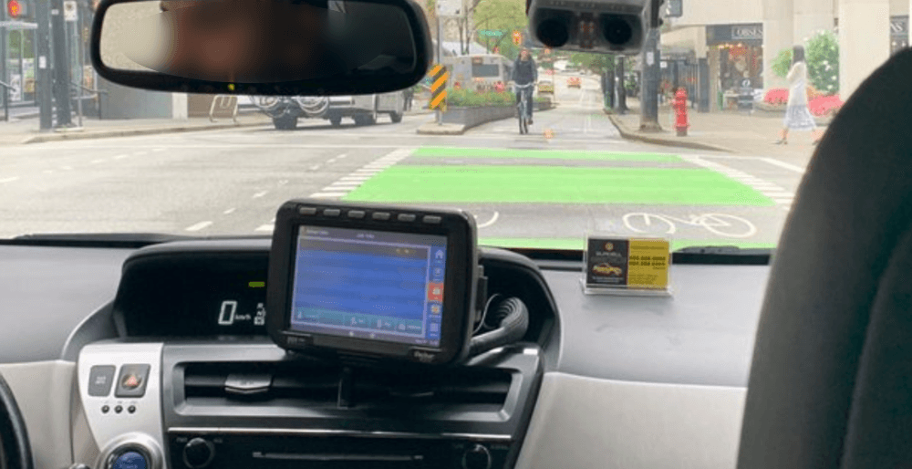 VPD investigate after cab caught driving in separated bike lane (VIDEO)