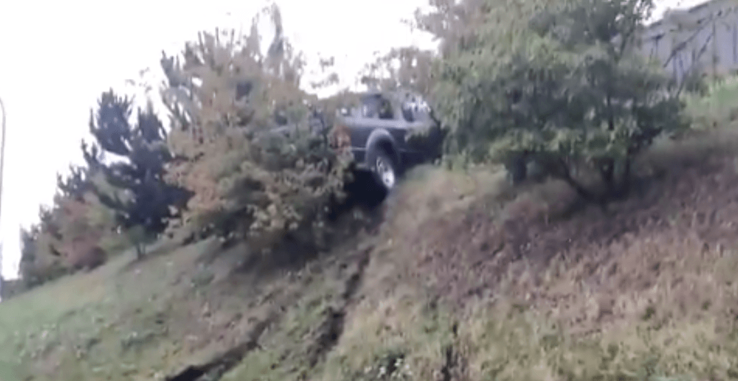 Truck ends up perched on very steep hill after awkward crash (VIDEO)