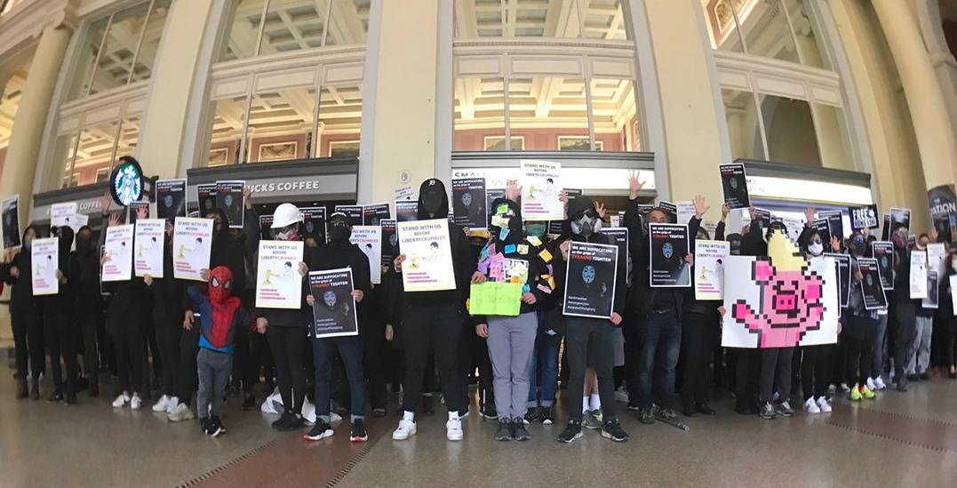 Student-led Hong Kong activists hold silent flash mob at Waterfront Station (PHOTOS)