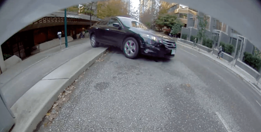 VIDEO: Dashcam footage of dramatic downtown Vancouver car rollover