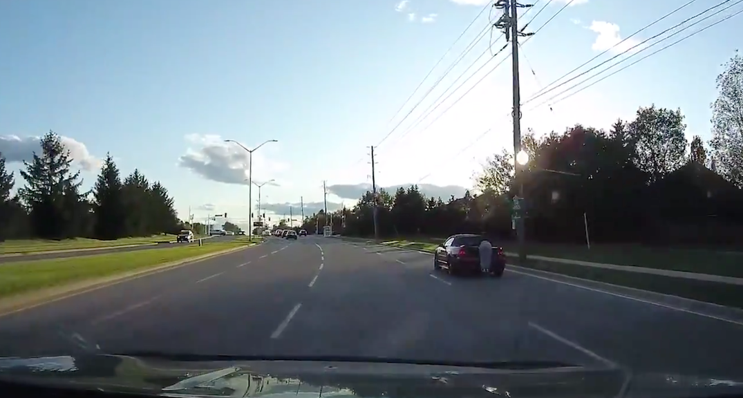 Someone was caught hanging off the back of convertible spoiler in Oakville (VIDEO)