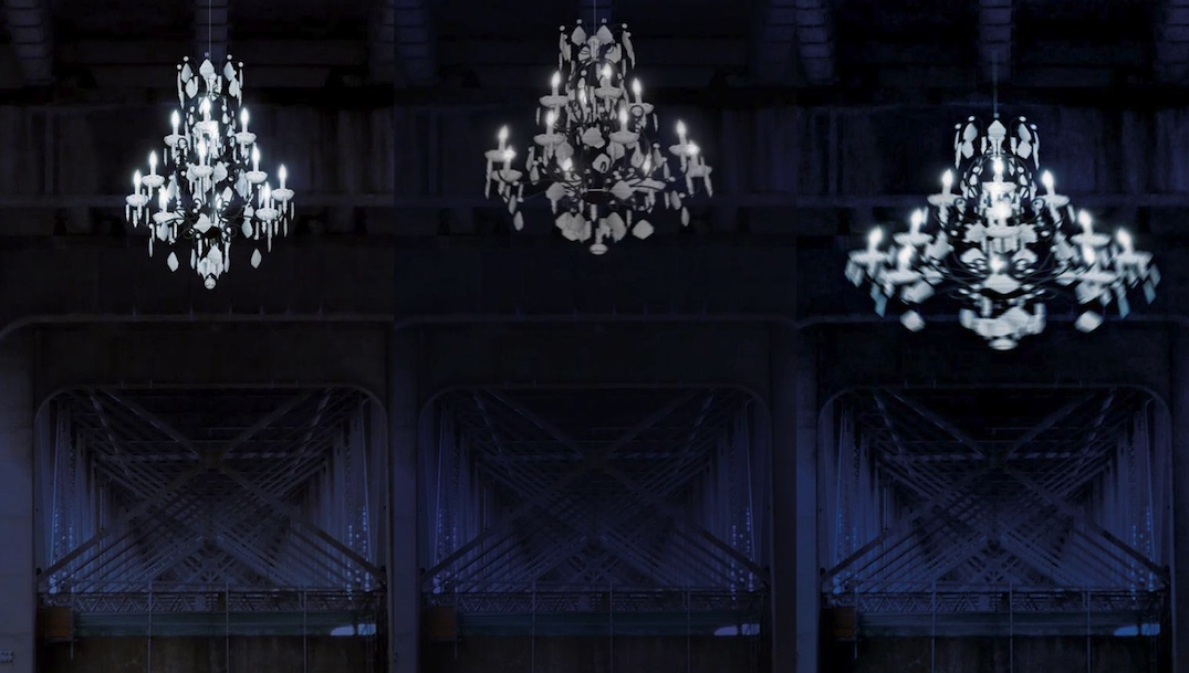Giant spinning chandelier being installed on Granville Bridge's underside
