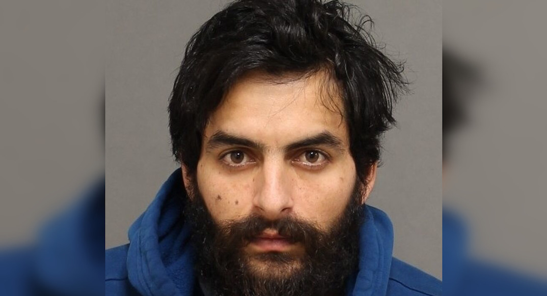 Man arrested for allegedly assaulting, photographing, and threatening international student
