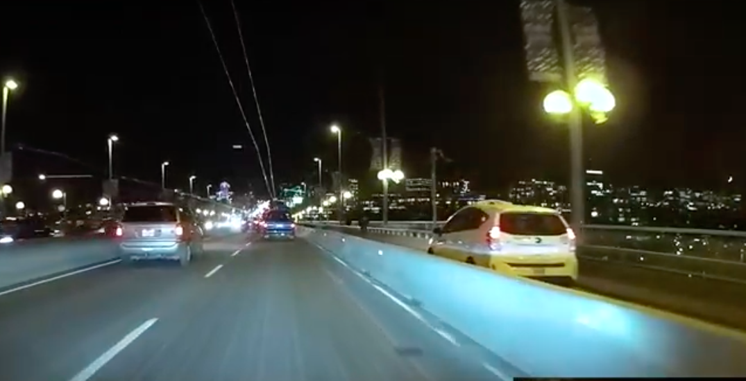 Taxi uses bike lane to cross Vancouver's Cambie Bridge (VIDEO)