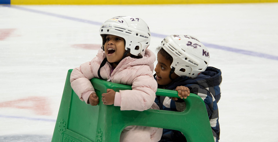 Refugee families try ice skating for the first time at Rogers Arena (PHOTOS)
