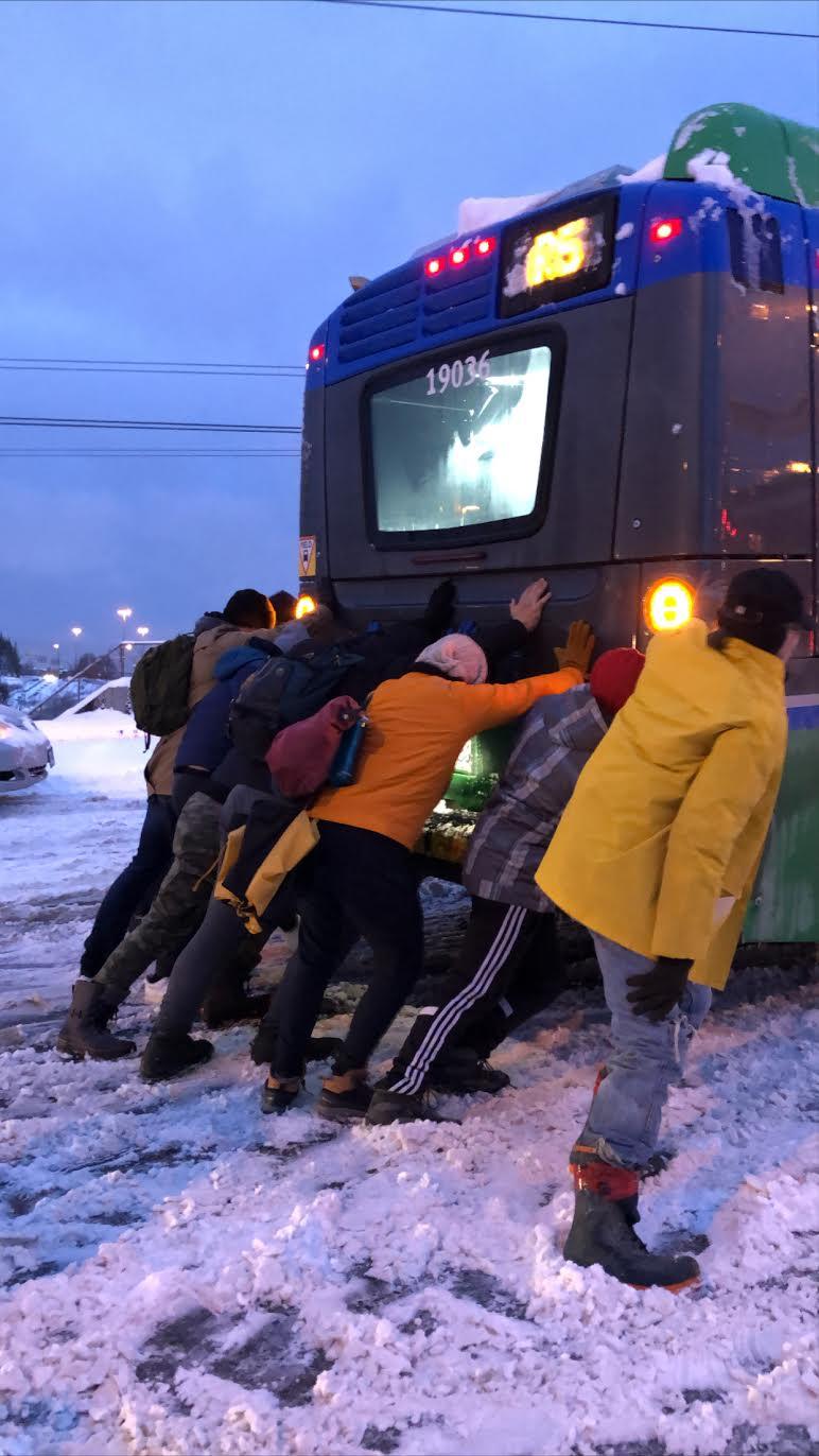 pushing bus snow