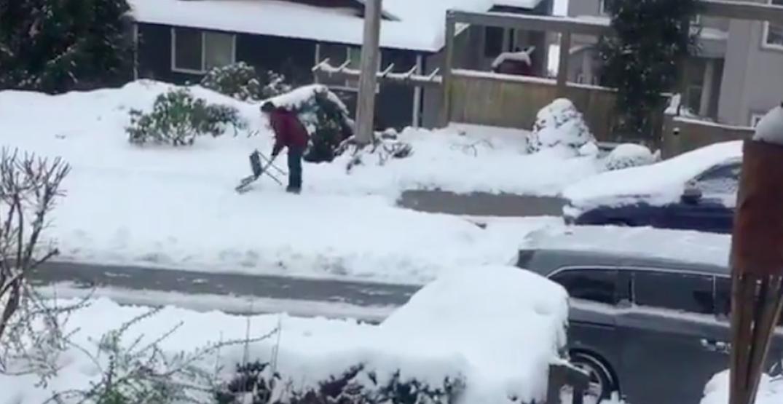 Peak Vancouver: Man uses folding chair to shovel snow (VIDEO)