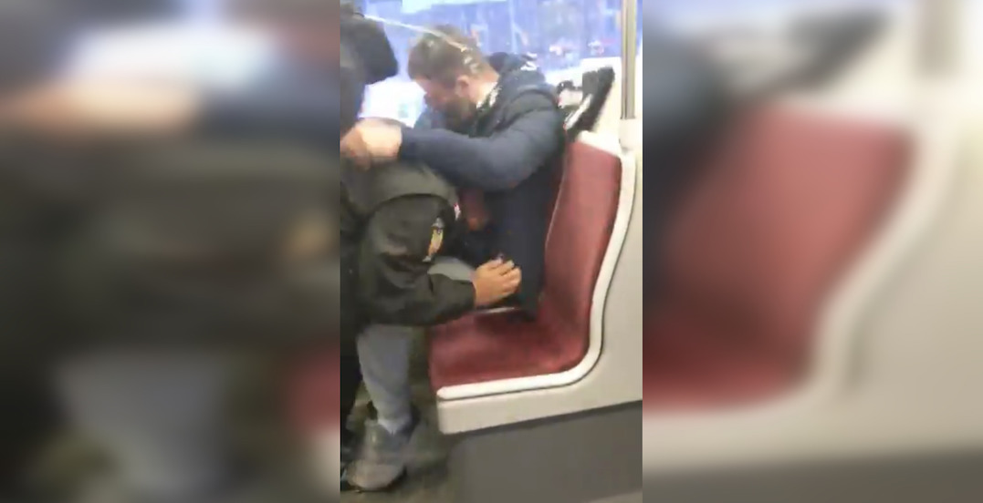 Man charged after video showed TTC constables and rider fighting on streetcar