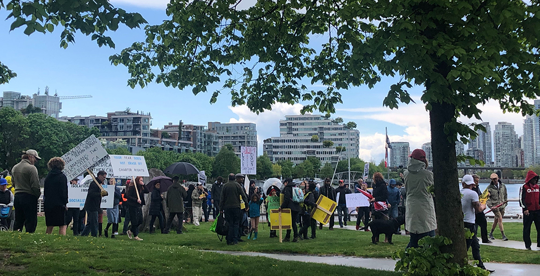 Protesters against coronavirus lockdown gather near False Creek