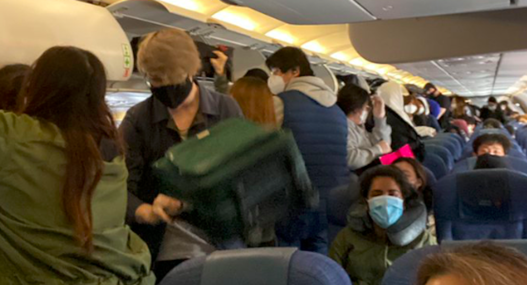 Passenger calls out Air Canada for not enforcing social distancing on flight