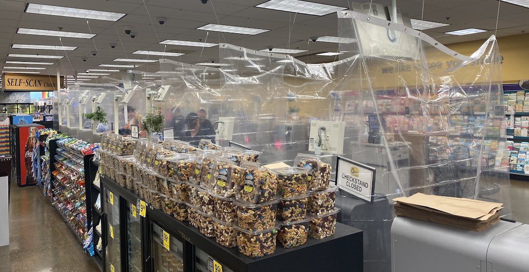 QFC stores in Seattle are adding plastic barriers between checkouts