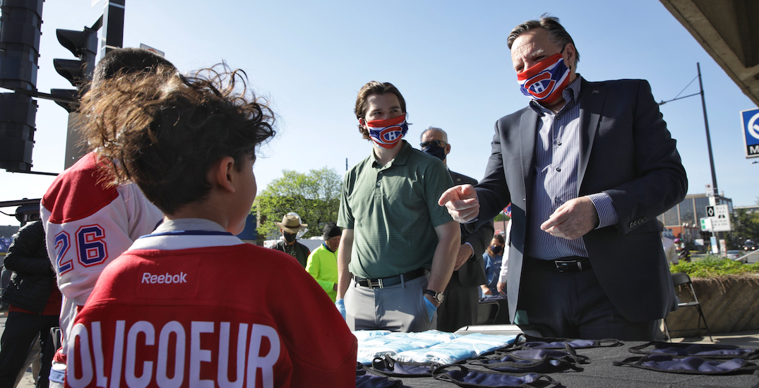 François Legault and Jonathan Drouin dish out Canadiens face masks at Montreal metro
