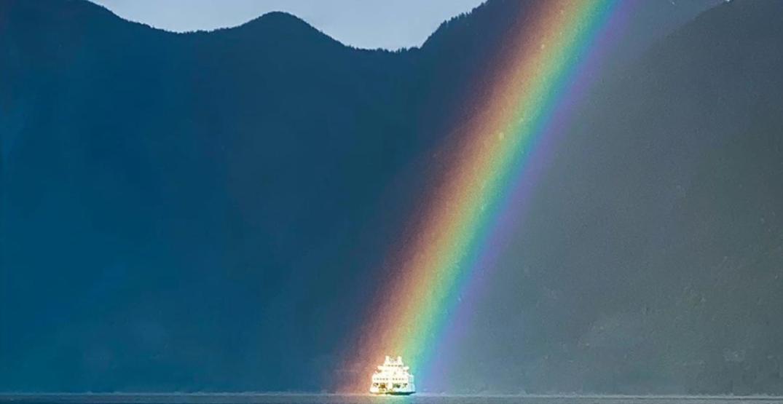 Photographer captures rainbow shining on Bowen Island ferry
