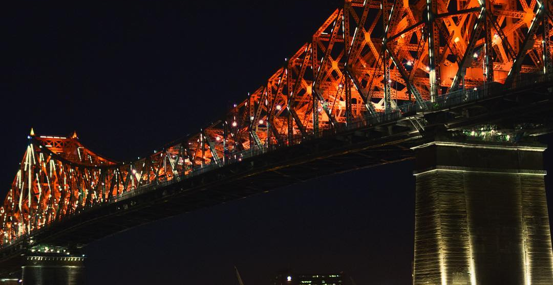 The Jacques Cartier Bridge will light up red tomorrow to celebrate Canada Day