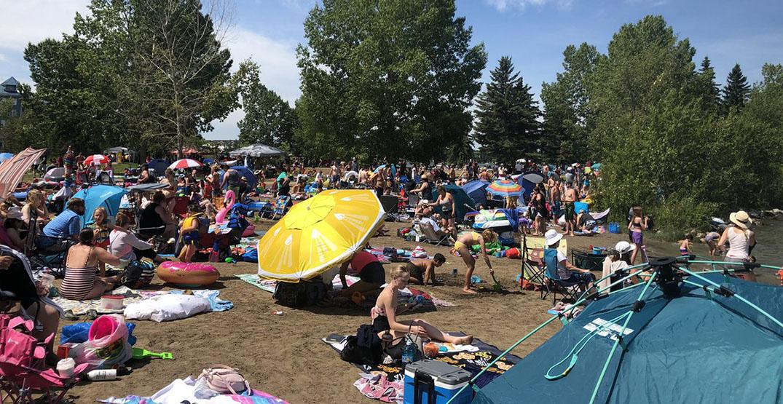 Sunbathers crowd Alberta beach on pandemic summer day