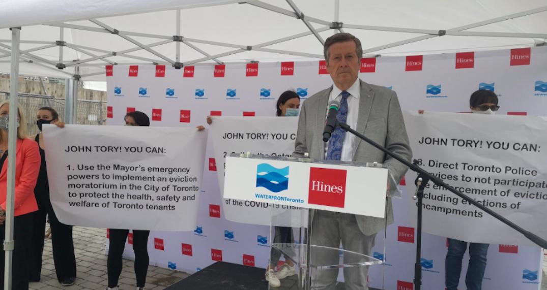 Protestors interrupt Mayor Tory's speech at a condo development ceremony
